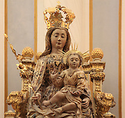 Virgen del Coro or Virgin Enthroned, 18th century alabaster sculpture by Joan de Castellnou, in the Metropolitan Cathedral-Basilica of the Assumption of Our Lady of Valencia, Valencia, Spain. The Virgin is crowned and seated on a throne holding a lily and the Christ child, who raises his hand in blessing. The cathedral is a Roman Catholic parish church consecrated in 1238 and reworked several times over the centuries. Picture by Manuel