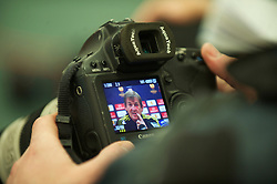 LIVERPOOL, ENGLAND, Wednesday, March 16, 2011: The image of Liverpool's manager Kenny Dalglish on a Reuters photographer's camera during a press conference at the club's Melwood Training Ground ahead of the UEFA Europa League Round of 16 2nd leg match against Sporting Clube de Braga. (Photo by David Rawcliffe/Propaganda)