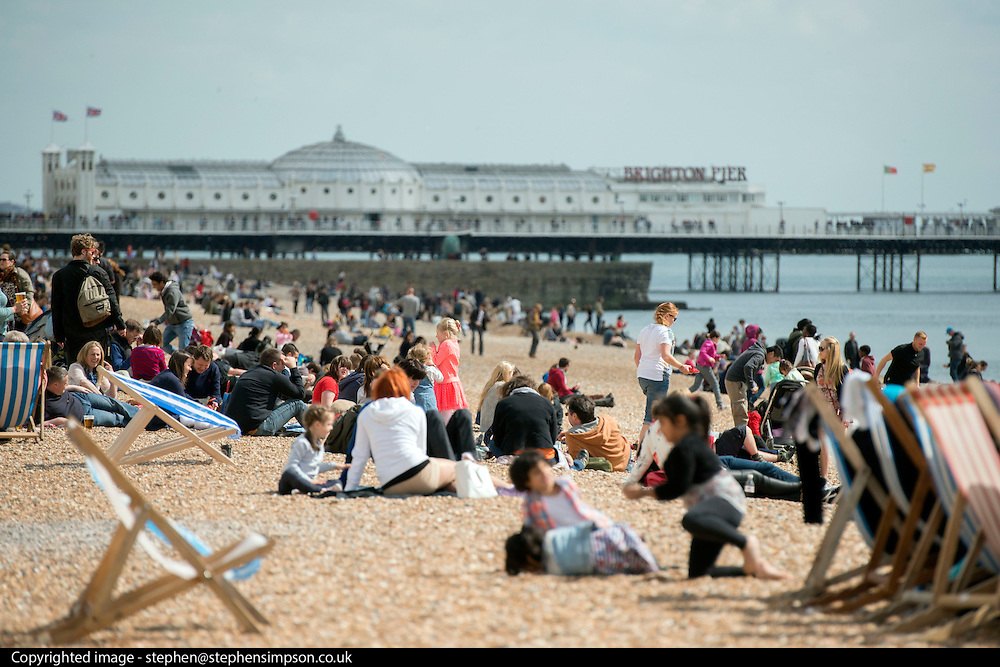 © Licensed to London News Pictures. 18/04/2014. Brighton, UK People enjoy the  bank holiday sunshine at Brighton today 18th April 2014. Photo credit : Stephen Simpson/LNP