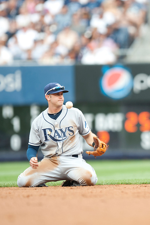 NEW YORK - AUGUST 13: Evan Longoria #3 of the Tampa Bay Rays fields his position during the game against the New York Yankees at Yankee Stadium on August 13, 2011 in the Bronx borough of Manhattan. (Photo by Rob Tringali) *** Local Caption *** Evan Longoria