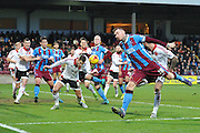 Jack King of Scunthorpe United just missis ball from the corner kick taken by Luke Williams of Scunthorpe United during the Sky Bet League 1 match between Scunthorpe United and Sheffield Utd at Glanford Park, Scunthorpe, England on 19 December 2015. Photo by Ian Lyall.