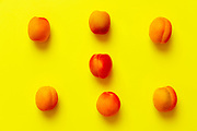 Apricots set of six  isolated over a yellow background viewed from above, flatlay style