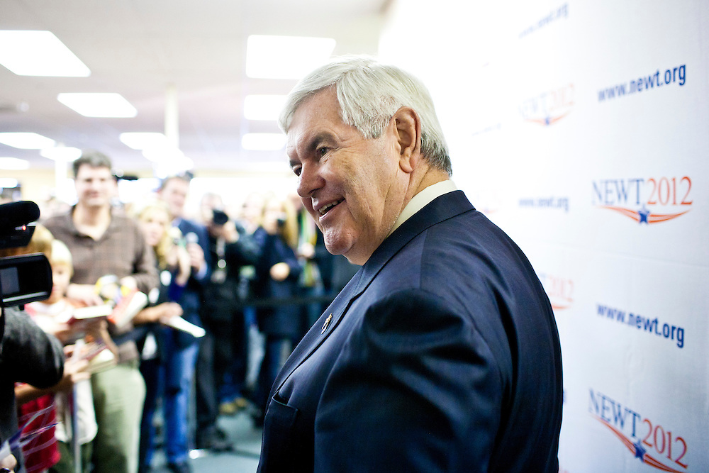 Republican presidential candidate Newt Gingrich arrives at the opening of a new campaign office on Saturday, December 10, 2011 in Urbandale, IA.
