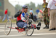 July 4th, 2006:  Anchorage, Alaska - Jose Nieves (382), a Army veteran from Gurabo, Puerto Rico, enters turn one of the 5k handcycle event at the 26th National Veterans Wheelchair Games..