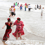 Just a quick dip for the flamenco dancers at the 2016 Folkestone Lions club boxing day dip.  An annual fancy dress fundraising event, Sunny Sands, Folkestone. UK