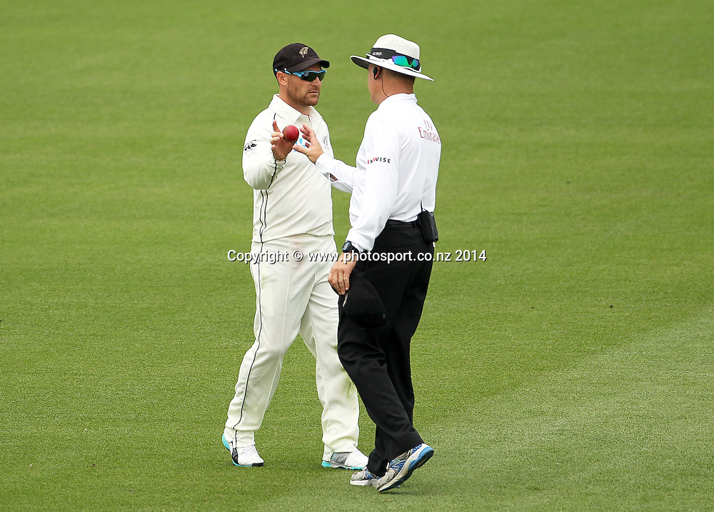 Brendon McCullum of the Black Caps hands the ball to umpire Bruce Oxenford after suspecting the ball to be out of shape on Day 2 of the boxing Day Cricket Test Match between the Black Caps v Sri Lanka at Hagley Oval, Christchurch. 27 December 2014 Photo: Joseph Johnson / www.photosport.co.nz
