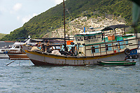 Fishing boats moored in Aberdeen fishing village, Hong Kong, Hong Kong, August 2008   Photo: Peter Llewellyn