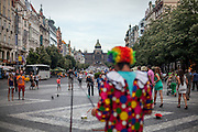 "A clown is preparing his ""bubble"" performance at Wenceslas Square in Prague."