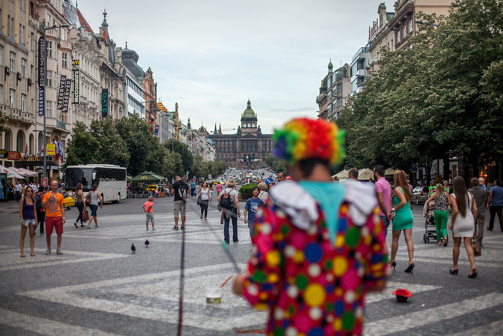"""A clown is preparing his """"bubble"""" performance at Wenceslas Square in Prague."""