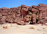 Natural rock formations at Timna natural and historic park, Israel, The Timna Valley is located in the southwestern Arava, some 30 km. north of the Gulf of Eilat. The traces of ancient civilizations are, too, very interesting to look at in Timna. Copper mining was known there at least from the 18th century B.C. Later Egyptians, who conquered the area, made Timna a very important source of copper. There are many ancient copper mines in the valley, some look like holes in the ground, others are caves hewn in stone; in some places, there are remains of copper-smelting ovens. There is a place where you can see Egyptian rock drawings. At the foot of Solomon's pillars there are remains of an Egyptian temple, and above them are two figures, one of them a pharaoh, engraved in stone by Egyptians.