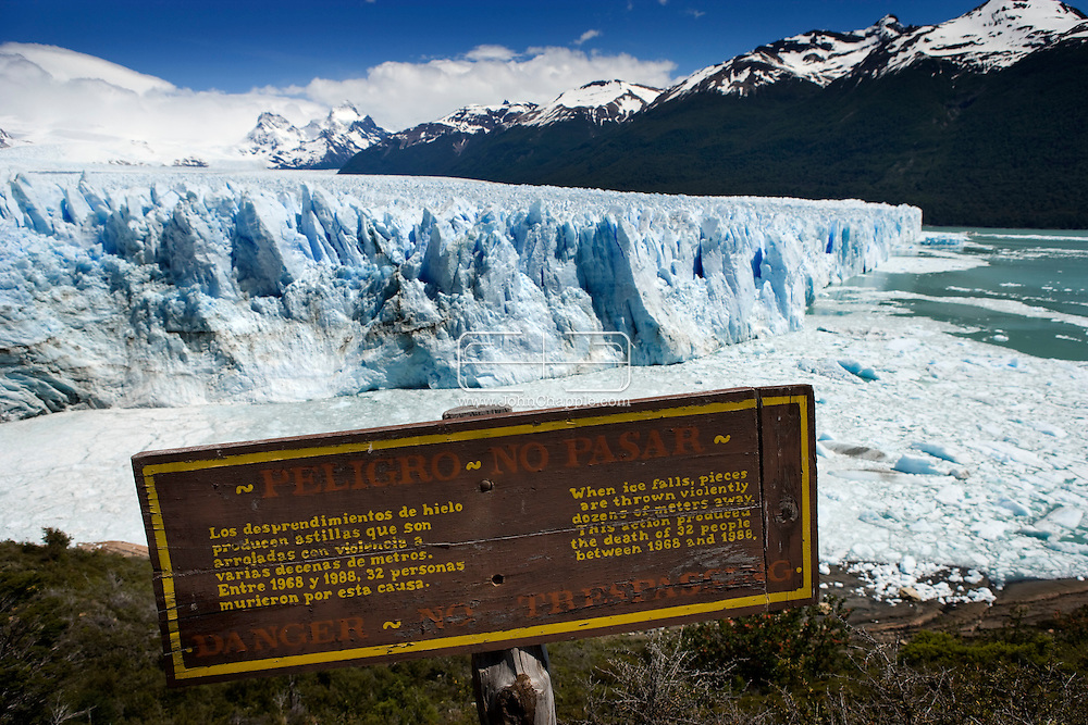 28th November 2007, Patagonian, Argentina. The Perito Moreno glacier, located 78 km from El Calafate, in Argentina was named after the explorer Francisco Moreno. The huge glacier is one of only three Patagonian glaciers that are not retreating. Standing 5 km wide, with an average height of 60 meters above the surface of the water, with a total ice depth of 170 meters. It advances at a speed of up to 2 meters per day (around 700 meters per year).PHOTO © JOHN CHAPPLE / REBEL IMAGES.john@chapple.biz    www.chapple.biz