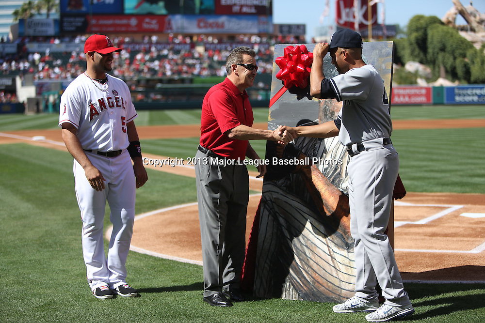 ANAHEIM, CA - JUNE 15:  (L-R) Albert Pujols #5 of the Los Angeles Angels of Anaheim looks on as Arte Moreno owner of the Los Angeles Angels of Anaheim shakes hands with Mariano Rivera #42 of the New York Yankees during a tribute to the pitcher before the game against the Los Angeles Angels of Anaheim on Saturday, June 15, 2013 at Angel Stadium in Anaheim, California. The Angels won the game 6-2. (Photo by Paul Spinelli/MLB Photos via Getty Images) *** Local Caption *** Albert Pujols;Arte Moreno;Mariano Rivera