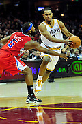 Feb. 11, 2011; Cleveland, OH, USA; Cleveland Cavaliers point guard Ramon Sessions (3) drives past Los Angeles Clippers point guard Baron Davis (5) during the second quarter at Quicken Loans Arena. Mandatory Credit: Jason Miller-US PRESSWIRE