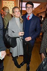 LAUREN PARK and CHRISTOPHER RAMSAY at a party to celebrate the publication of Capability Brown & Belvoir - Discovering a lost Landscape by The Duchess of Rutland, held at Christie's, 8 King Street, St.James, London on 7th October 2015.