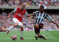 Photo: Ed Godden.<br />Arsenal v Sheffield United. The Barclays Premiership. 23/09/2006. Arsenal's Fredrik Ljungberg (L) is tackled by Colin Kazim-Richards.