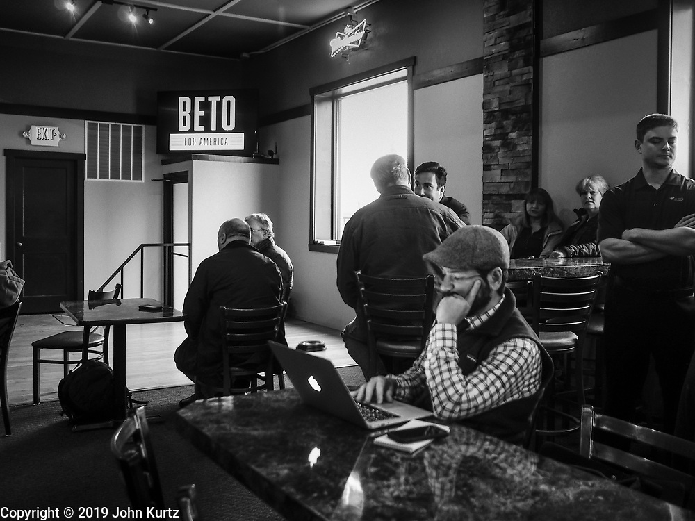 04 APRIL 2019 - CARROLL, IOWA:  People wait for Beto O'Rouke to arrive. Beto O'Rourke stopped at Kerps Tavern in Carroll, IA, to campaign for president Thursday. He is crisscrossing Iowa through the weekend with stops throughout the state. Iowa holds its caucuses, considered the kickoff of the US Presidential campaign, on Feb. 3, 2020.    PHOTO BY JACK KURTZ