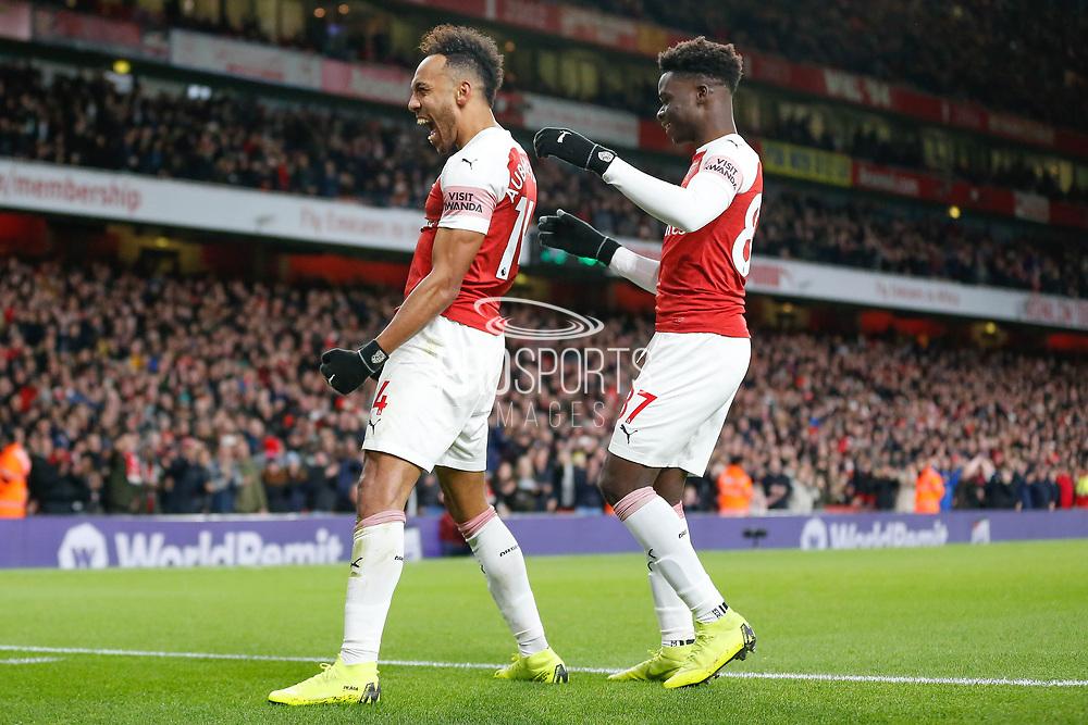 GOAL 4-1 Arsenal striker Pierre-Emerick Aubameyang (14) celebrates with Arsenal midfielder Bukayo Saka (87) after Arsenal's fourth during the Premier League match between Arsenal and Fulham at the Emirates Stadium, London, England on 1 January 2019.