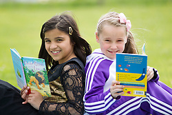 Repro Free: 23/05/2013 Time to Read @ ITB .Zainab Awais and Damaris Coroama pupils of Castaheany Educate Together NS are pictured celebrating with a Tea Party, the completion of ITB's (Institute of Technology Blanchardstown) first 'Time to Read' Project. The 24 week programme with volunteer readers from ITB, helped the children develop a love of reading whilst encrouaging them to become independent readers. Pic Andres Poveda..www.itb.ie .For further information please contact Ann-Marie Sheehan, Aspire PR T : 0872985569 E : annmarie@aspire-pr.com.