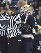 Officials work to restrain Notre Dame's Kyle Palmieri (right) after a scuffle in front of the Irish net during Saturday nights game against the Lake Superior State Lakers in Sault Ste. Marie.