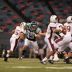 20 September 2008: Tulane defensive end Logan Kelley (93) pressures Louisiana-Monroe quarterback Kinsmon Lancaster (7) during a Conference USA match up between the University of Louisiana Monroe and Tulane at the Louisiana Superdome in New Orleans, LA.