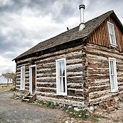 Log cabin at the Clear Creek History Park in Golden, Colorado, showing the historic frontier life of the region's early settlers.