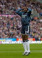 Photo: Glyn Thomas.<br />West Bromwich Albion. Newcastle Utd. The Barclays Premiership. 30/10/2005.<br /> Newcastle's Shola Ameobi holds his head in his hands after missing a great chance to score.