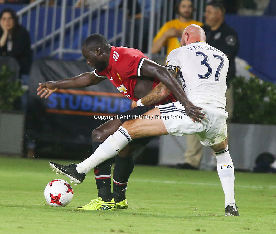 Manchester United Romelu Lukaku, left, and Los Angeles Galaxy  Jelle Van Damme battle for the ball during the second half of a national friendly soccer game at StubHub Center on July 15, 2017 in Carson, California. The Manchester United won 5-2. AFP PHOTO / Ringo Chiu