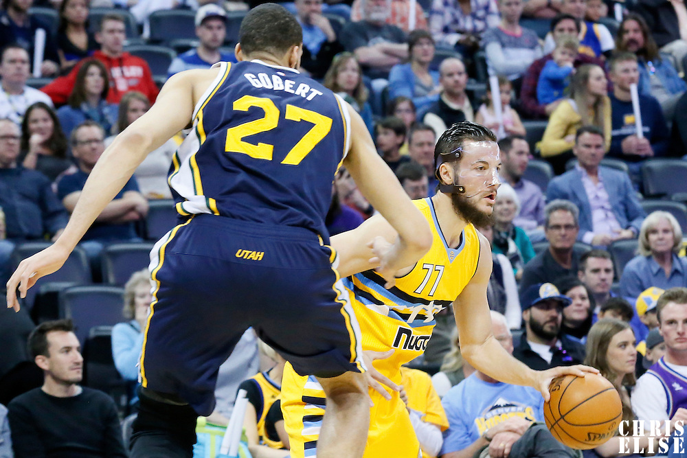 10 April 2016: Denver Nuggets center Joffrey Lauvergne (77) drives past Utah Jazz center Rudy Gobert (27) during the Utah Jazz 100-84 victory over the Denver Nuggets, at the Pepsi Center, Denver, Colorado, USA.