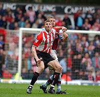 2003-05-03<br />Barclaycard Premiership<br />Aston Villa v Sunderland<br /><br />SUNDERLAND STRIKER TORE ANDRE FLO BATTLES WITH ASTON VILLA'S OLAF MELLBERG  DURING TODAYS PREMIERSHIP GAME.<br />PIC BY DANIEL HAMBURY/SPORTSBEAT IMAGES