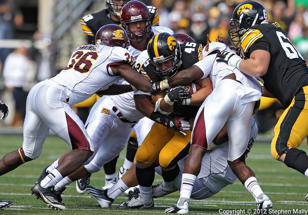 September 22 2012: Iowa Hawkeyes fullback Mark Weisman (45) is brought down by the Central Michigan Chippewas defense during the second half of the NCAA football game between the Central Michigan Chippewas and the Iowa Hawkeyes at Kinnick Stadium in Iowa City, Iowa on Saturday September 22, 2012. Central Michigan defeated Iowa 32-31.