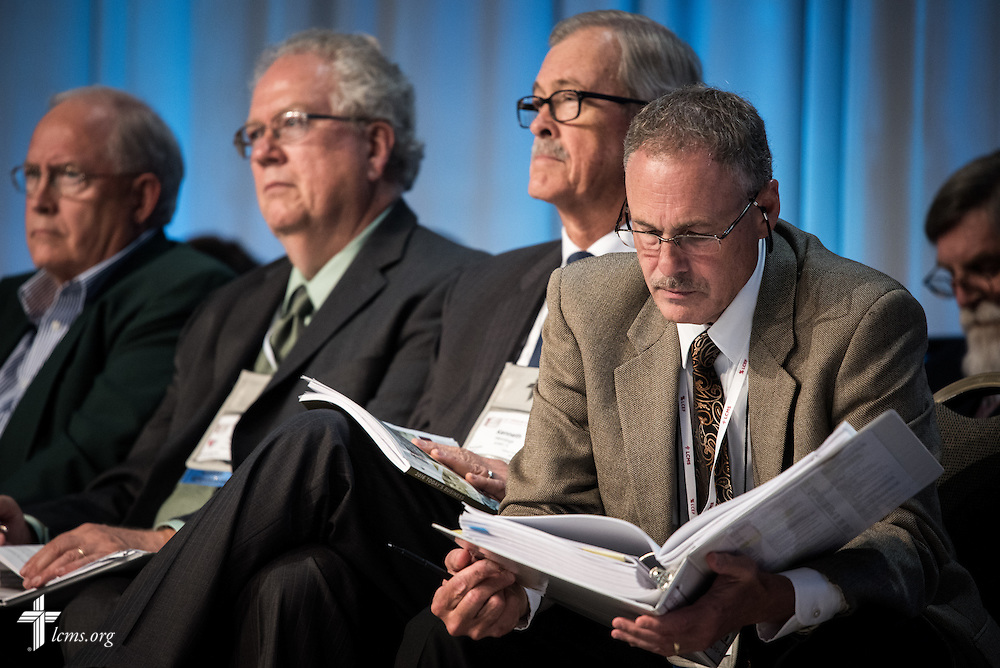 Rev. Dr. Joel D. Lehenbauer, LCMS executive director of the Commission on Theology and Church Relations, reads during Floor Committee 5 on Tuesday, July 12, 2016, at the 66th Regular Convention of The Lutheran Church–Missouri Synod, in Milwaukee. LCMS/Erik M. Lunsford