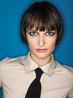 Woman wearing tie head and shoulders in studio