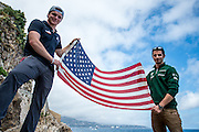 Monaco Grand Prix 2014, GP2 drivers Conor Daly (left) and Alexander Rossi hold an American flag near Monaco's harbor.