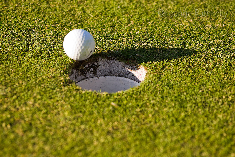 Golfers enjoy a round of golf on a summer evening in Whistler, BC Canada
