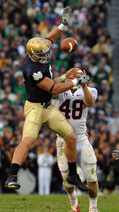 Stanford Cardinal linebacker Owen Marecic (48) breaks up a pass intended for Tight end Kyle Rudolph (9)...