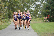 Washington Huskies runners Allie Schadler (1277), Lilli Burdon (1268), Shona McCulloch (1274) and Katie Rainsberger (1276) lead the pack in the women's 3 mile run at the UW/Seattle University Open race at Warren G. Magnuson Park, Friday, Aug. 30, 2019, in Seattle. (Paul Merca/Image of Sport)
