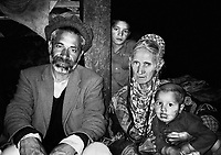 Pakistan, Northwest Frontier Province, 2004. Three generations of the Lal family, based in Birir, one of the three main Kalash villages in Pakistan's NWFP.