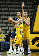 26 JANUARY 2009: Michigan center Krista Phillips (25) is guarded by Iowa guard Kristi Smith (11) and Iowa center Megan Skouby (44) during the first half of an NCAA women's college basketball game Monday, Jan. 26, 2009, at Carver-Hawkeye Arena in Iowa City, Iowa. Iowa defeated Michigan 77-69.