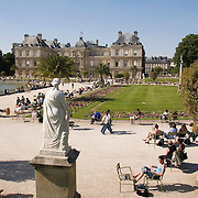 People enjoy sunny afternoon at the Palais and Jardin du Luxembourg Paris France<br />