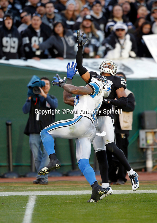 Oakland Raiders cornerback Stanford Routt (26) breaks up a fourth quarter pass intended for Detroit Lions wide receiver Calvin Johnson (81) during the NFL week 15 football game on Sunday, December 18, 2011 in Oakland, California. The Lions won the game 28-27. ©Paul Anthony Spinelli