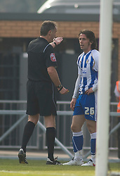 COLCHESTER, ENGLAND - Saturday, April 24, 2010: Colchester United's David Prutton is wrongly sent off after player confusion by Referee Mr. P.Crossley for a double yellow card after kicking the ball away in injury time during the Football League One match at the Western Community Stadium. (Photo by Gareth Davies/Propaganda)