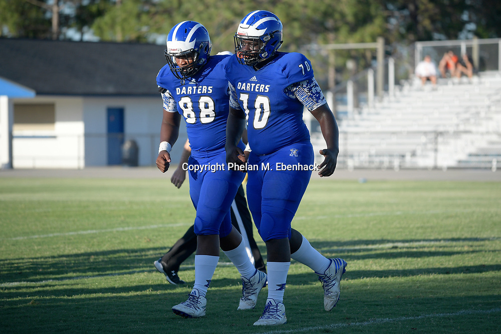 Apopka offensive lineman Ed Montilus (70) and tight end Jalen Carter (88) jog off the field against Orange City University during the first half of a spring high school football game in Apopka, Fla., Thursday, May 25, 2017. (Photo by Phelan M. Ebenhack)