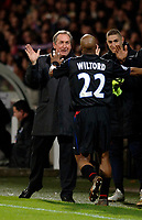Photo: Daniel Hambury.<br />Lyon v PSV Eindhoven. UEFA Champions League. 03/08/2006.<br />Lyon's Sylvain Wiltord celebrates his goal with manager Gerard Houllier.