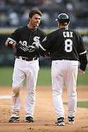 CHICAGO - APRIL 7:  Nick Swisher #30 of the Chicago White Sox talks to Jeff Cox during the game against the Minnesota Twins at U.S. Cellular Field in Chicago, Illinois on April 7, 2008.  The White Sox defeated the Twins 7-4.  (Photo by Ron Vesely)