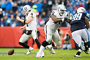 NASHVILLE, TN - NOVEMBER 29:  Derek Carr #4 of the Oakland Raiders chases down his fumbled snap during a game against the Tennessee Titans at Nissan Stadium on November 29, 2015 in Nashville, Tennessee.  The Raiders defeated the Titans 24-21.  (Photo by Wesley Hitt/Getty Images) *** Local Caption *** Derek Carr