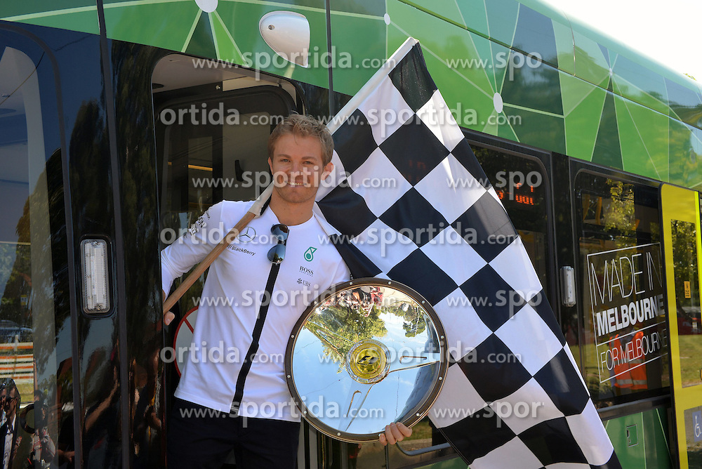 11.03.2015, Albert Park Circuit, Melbourne, AUS, FIA, Formel 1, Grand Prix von Australien, Vorberichte, im Bild Nico Rosberg (GER) Mercedes AMG F1 with his 2014 Australian GP winners trophy aboard the Rosberg Express tram // during Preparations for the FIA Formula One Grand Prix of Australia at the Albert Park Circuit in Melbourne, Australia on 2015/03/11. EXPA Pictures &copy; 2015, PhotoCredit: EXPA/ Sutton Images/ John Toscano Images<br /> <br /> *****ATTENTION - for AUT, SLO, CRO, SRB, BIH, MAZ only*****