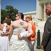 Twenty-five gay couples traveled to Washington on the C-Bus of Love to get married en masse the week before decisions are expected to be made on the Defense of Marriage Act (DOMA) and Proposition 8. John Boal photography