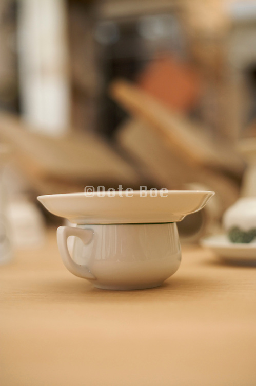 coffee cup with saucer placed on top