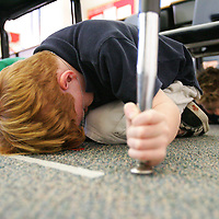 Crystal Chatham The Desert Sun<br /> <br /> 11/13/2008 -- Cahuilla Elementary School second grader Cameron Lumbert, 7, of Palm Springs grabs hold of his desk's table legs during a simulated magnitude 7.8 earthquake on Thursday, November 13. The 10 a.m. drill was conducted as part of the The Great Southern California ShakeOut.