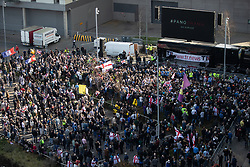 "© Licensed to London News Pictures . 23/02/2019. Salford, UK. TOMMY ROBINSON SUPPORTERS . Supporters of Tommy Robinson (real name Stephen Yaxley-Lennon ) and anti-fascists opposed to the former EDL leader and his followers , gather near to the BBC at Media City to protest , as Yaxley-Lennon hosts a rally showing a home-made documentary , "" Panodrama "" , described as an exposé of the BBC's Panorama documentary series . A BBC Panorama documentary is due to feature an investigation in to Yaxley-Lennon in the near future . Photo credit: Joel Goodman/LNP"